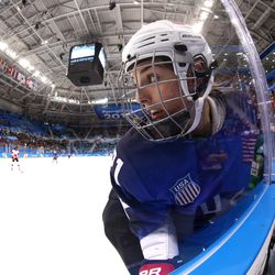 Hilary Knight #21 of the United States skates along the boards in the second period.