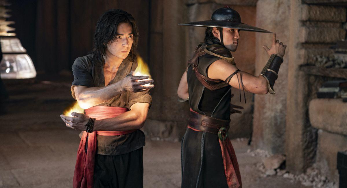 Ludi Lin as Liu Kang and Max Huang as Kung Lao pose before fighting in Mortal Kombat
