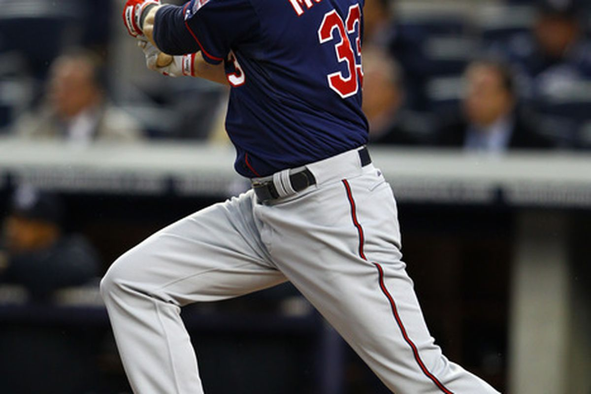 NEW YORK, NY - APRIL 18:  Justin Morneau #33 of the Minnesota Twins hits a two run home run against the New York Yankees during their game on April 18, 2012 at Yankee Stadium in the Bronx borough of New York City.  (Photo by Al Bello/Getty Images)