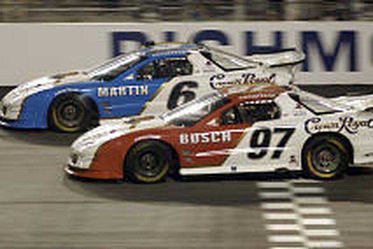 Mark Martin (6) and Kurt Busch hit the finish line at Richmond International Raceway on Thursday. Martin edged out Busch by .021 seconds.