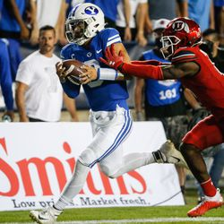 Brigham Young Cougars quarterback Jaren Hall gets pushed by Utah Utes cornerback Clark Phillips III during the second half of an NCAA college football game at LaVell Edwards Stadium in Provo on Saturday, Sept. 11, 2021. BYU won 26-17.