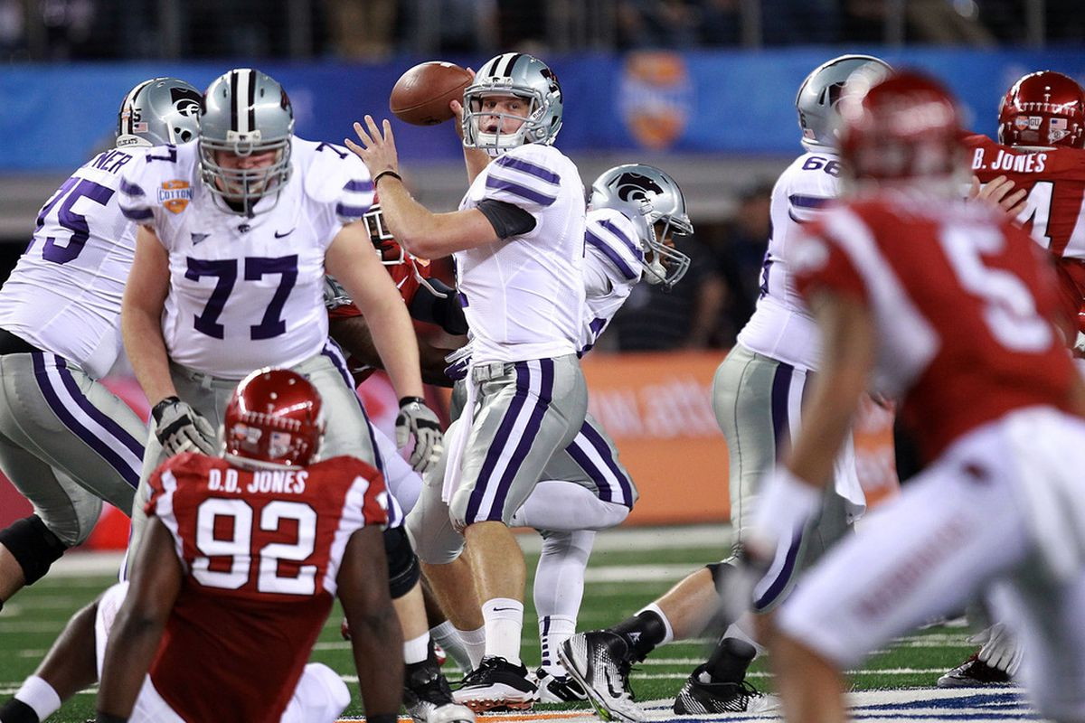ARLINGTON, TX - JANUARY 06:  Collin Klein #7 of the Kansas State Wildcats throws against the Arkansas Razorbacks during the Cotton Bowl at Cowboys Stadium on January 6, 2012 in Arlington, Texas.  (Photo by Ronald Martinez/Getty Images)