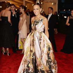 Sarah Jessica Parker in Giles, Christian Louboutin boots, and a Philip Treacy headpiece in 2013.