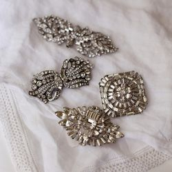 """""""Vintage brooches I found for the backs of the bridesmaid dresses."""""""