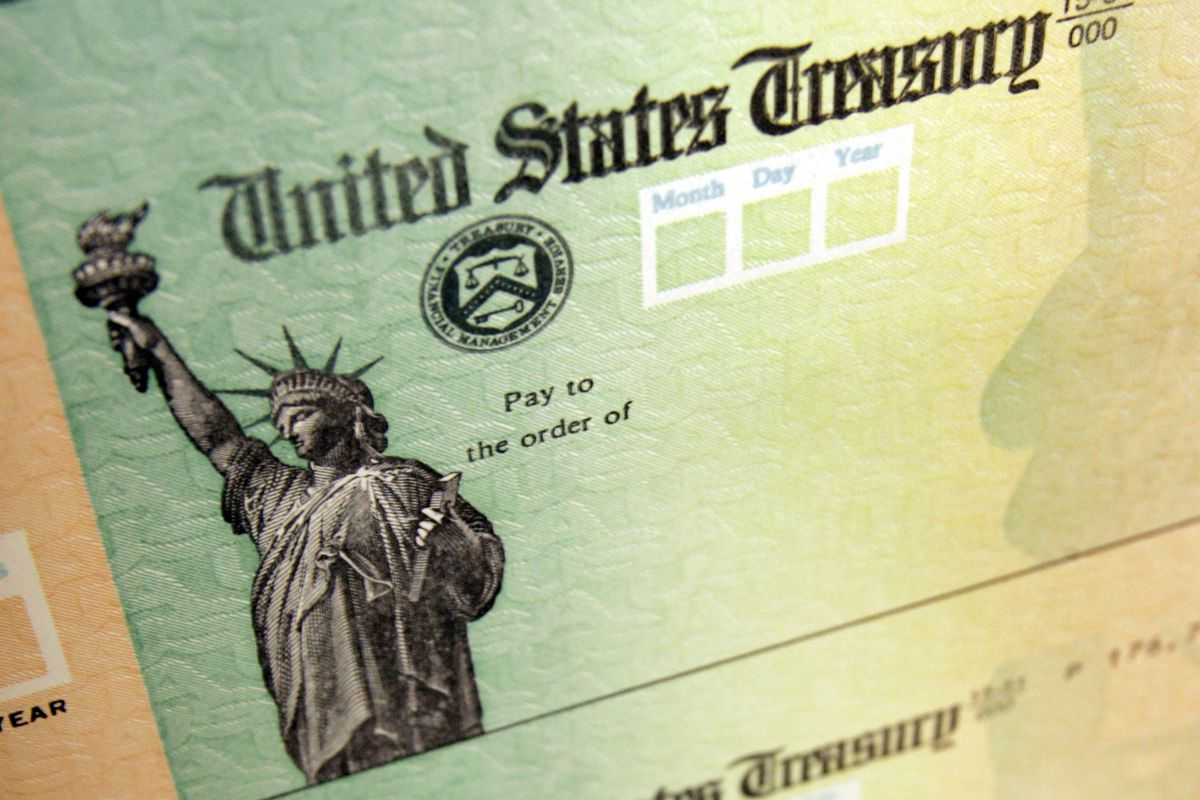 Blank checks sit on an idle press at the Philadelphia Regional Financial Center, which disburses payments, such as stimulus checks, on behalf of federal agencies.