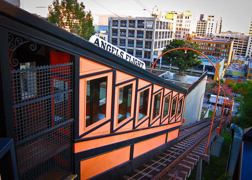 An orange railway station exterior. There is a sign on top that reads Angels Flight.