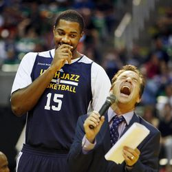 David Locke enjoys a Derrick Favors joke as Favors is introduced before the Utah Jazz's scrimmage in Salt Lake City, Saturday, Oct. 5, 2013.