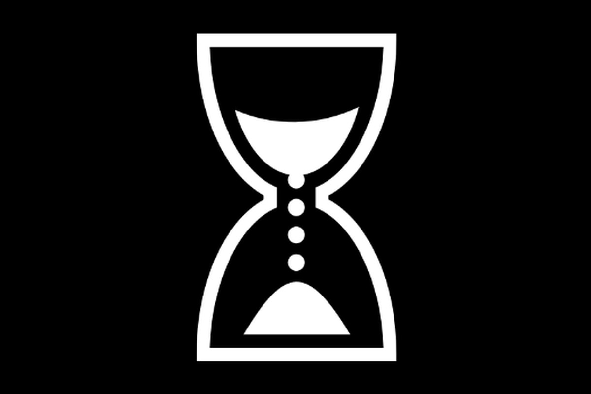 A white hourglass symbol on a black background