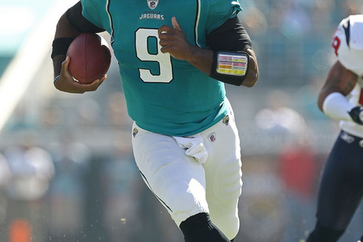 JACKSONVILLE FL - NOVEMBER 14: David Garrard #9 of the Jacksonville Jaguars runs the ball during a game against the Houston Texans at EverBank Field on November 14 2010 in Jacksonville Florida.  (Photo by Mike Ehrmann/Getty Images)