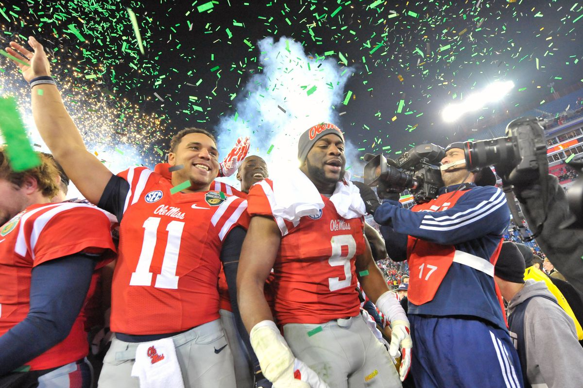 L-to-R: Barry Brunetti and D.T. Shackelford celebrate the Rebels' Music City Bowl win.