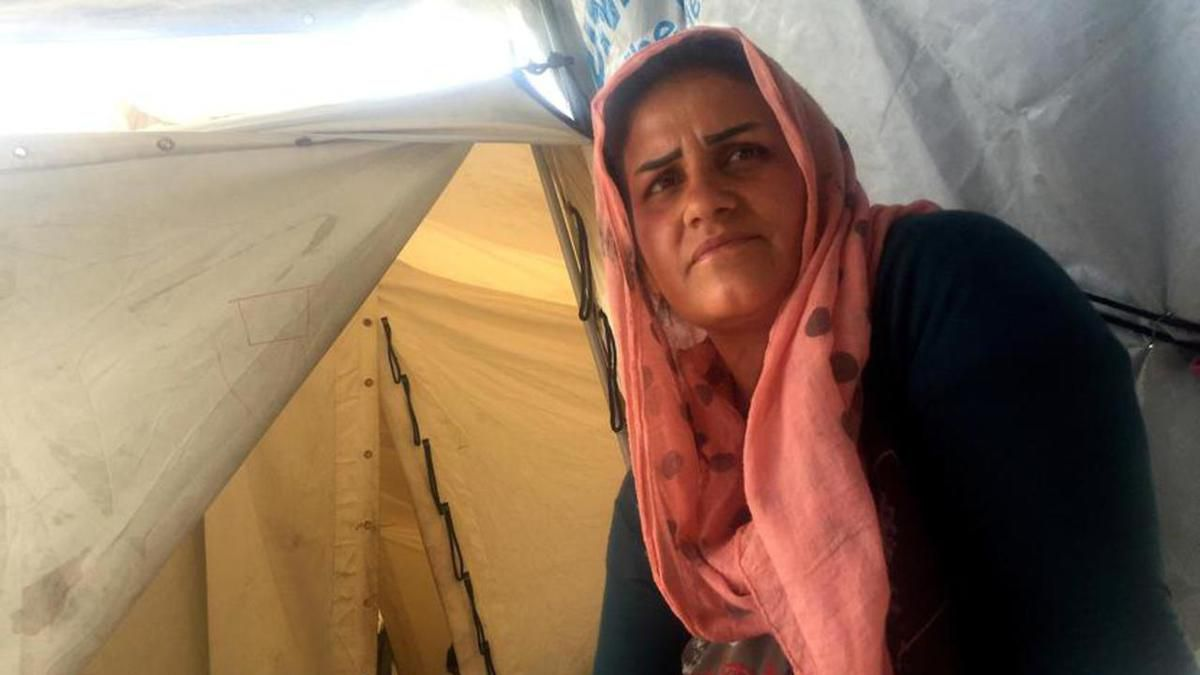 Rouya Addin, 30, lives with her four children, all under the age of 8, in a one-room tent in the Diavota refugee camp in northern Greece. She's among thousands of refugees who were stranded apart from their families when European countries closed their bo