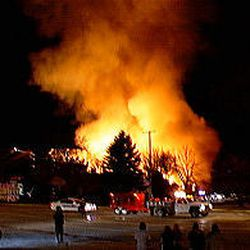 The fire in Smithfield rages on Tuesday; the building was destroyed.