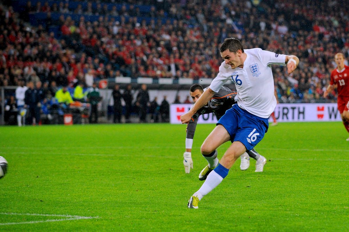 Adam Johnson hits England's second goal in their 3-1 victory over Switzerland during their Euro 2012 qualifier. (Photo by Michael Regan/Getty Images)