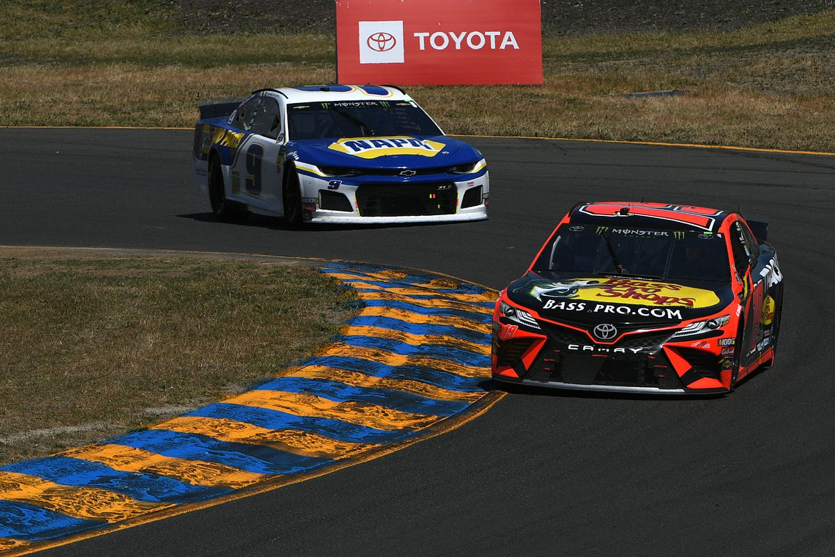 Martin Truex Jr., driver of the #19 Bass Pro Shops Toyota, leads Chase Elliott, driver of the #9 NAPA Auto Parts Chevrolet, during the Monster Energy NASCAR Cup Series Toyota/Save Mart 350 at Sonoma Raceway on June 23, 2019 in Sonoma, California.