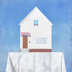 """Justin Wheatley's """"Altar"""" represents the artist's style of creating religious art, using symbolism that religious people can recognize and relate to, such as homes."""