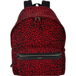 """All those Jansport feels in a print called """"babycat pattern"""" by <b>Saint Laurent</b>. Yours for <a href=""""http://www.barneys.com/on/demandware.store/Sites-BNY-Site/default/Product-Show?pid=00505032032024&cgid=BARNEYS&index=28"""">$950</a>—that's right, no com"""