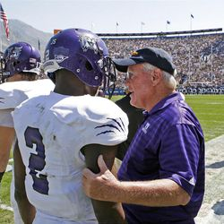 Former Weber State and University of Utah coach Ron McBride encourages Weber State Wildcats safety Willie Okwuonu (2) during the first half as Brigham Young University plays Weber State University in football  Saturday, Sept. 8, 2012, in Provo, Utah.