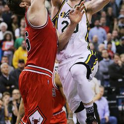 Utah Jazz forward Gordon Hayward (20) hits a shot to tie the game in regulation during NBA basketball in Salt Lake City, Monday, Feb. 1, 2016. At left is Chicago Bulls center Pau Gasol (16).