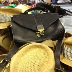 $80 Madewell bag on a bed of $15 hats.