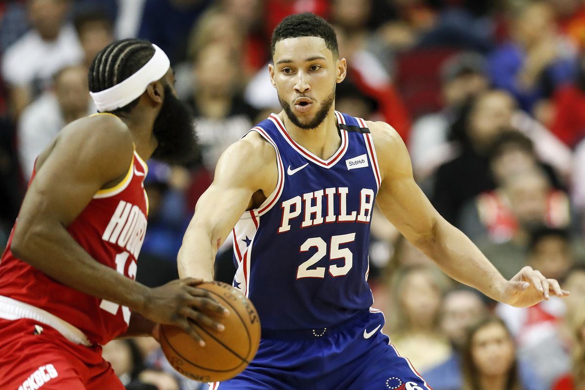 Ben Simmons of the Philadelphia 76ers defends James Harden of the Houston Rockets in the first half at Toyota Center on January 03, 2020 in Houston, Texas.
