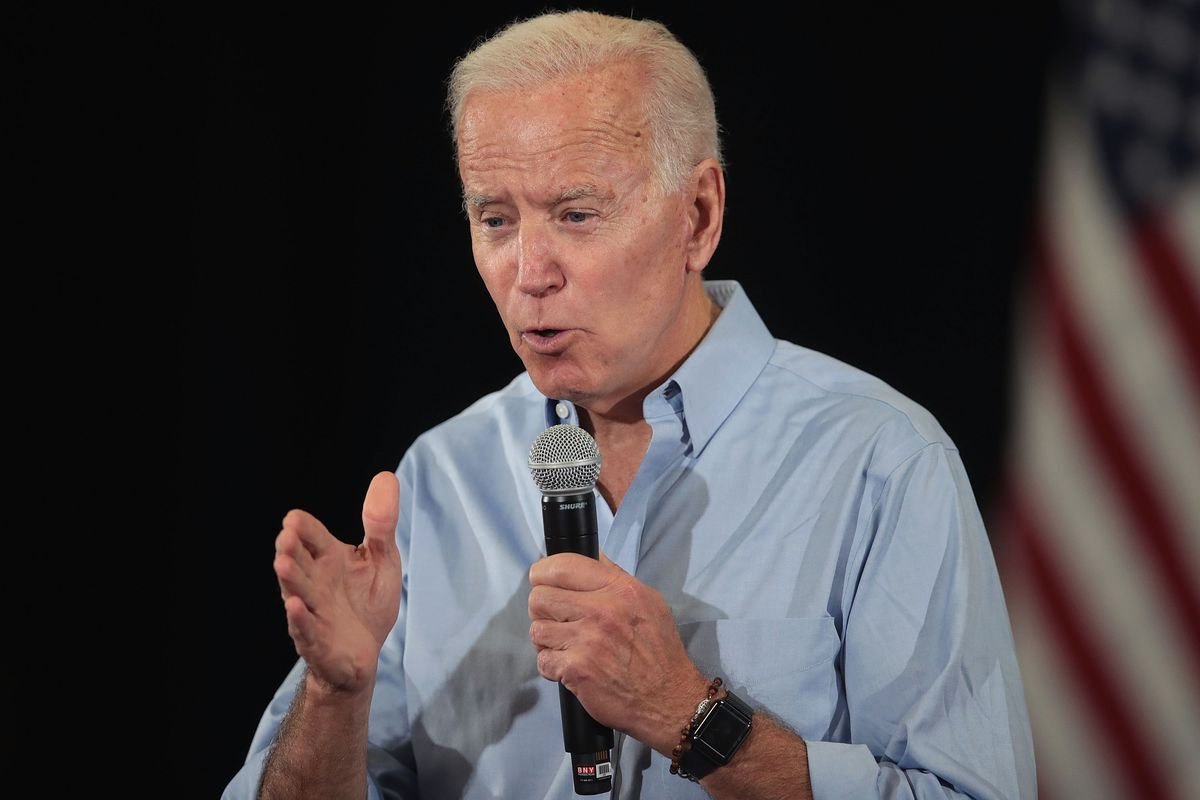 Former Vice President Joe Biden onstage holding a microphone.
