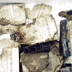 Fragments of books were recovered Aug. 13, 1993, from the Salt Lake Temple record stone. Items were placed in 1857 but damaged by moisture and condensation inside the foundation stone over the 136-year period.