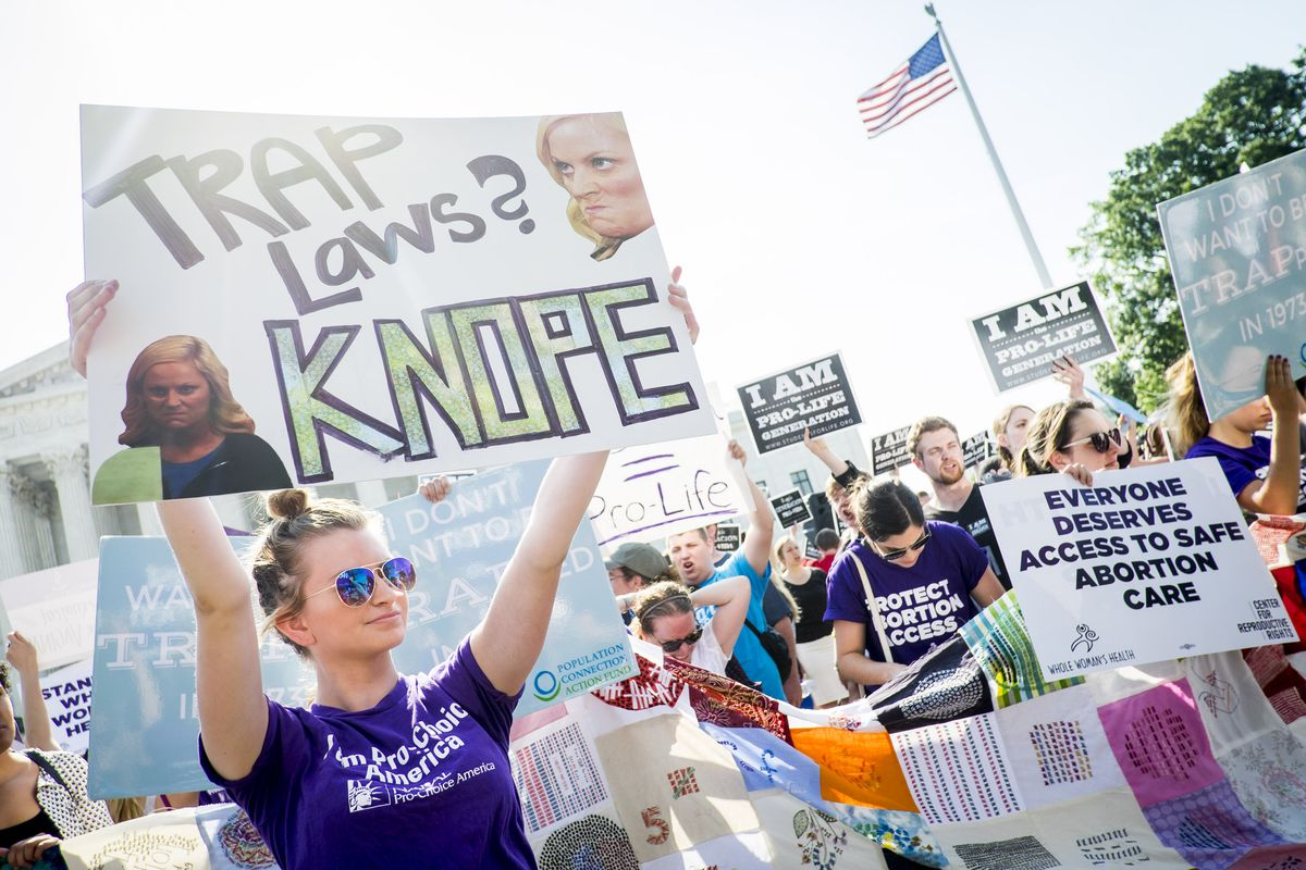Pro-choice and pro-life activists demonstrate on the steps of the United States Supreme Court on June 27, 2016, in Washington, DC.
