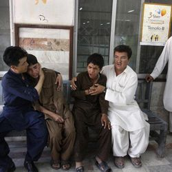 Pakistani Shiite Muslims mourn over the death of their relative killed by unknown gunmen, at a local hospital in Quetta, Pakistan on Saturday, Sept. 1, 2012. A group of gunmen on motorcycles in the southwestern province of Baluchistan killed several Shiite Muslims, as violence against the minority sect continues to escalate.