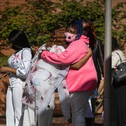 Mourners hug outside Abundant Living Christian Center in Dolton, Ill. during the wake and funeral of eight-year-old DaJore Wilson Friday morning, Sept. 18, 2020. Wilson was fatally shot in Canaryville Sept. 7.