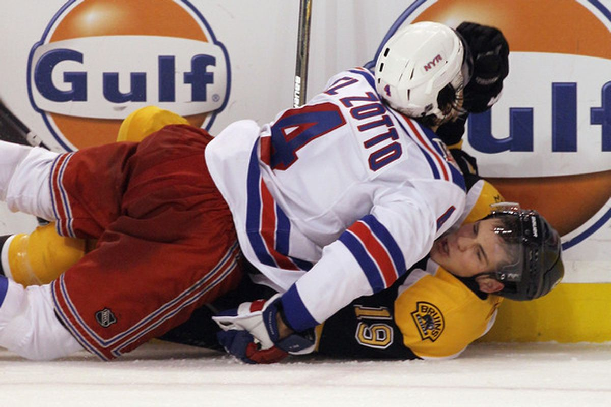 BOSTON - OCTOBER 23: Michael Del Zotto #4 of the New York Rangers checks Tyler Seguin #19 of the Boston Bruins at the TD Garden on October 23 2010 in Boston Massachusetts. The Rangers defeated the Bruins 3-2. (Photo by Bruce Bennett/Getty Images)