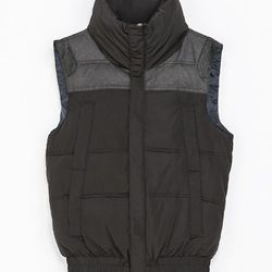 """<strong>Zara</strong> Contrasting Quilted Waistcoat in Black, <a href=""""http://www.zara.com/us/en/man/jackets/contrasting-quilted-waistcoat-c496501p1436188.html"""">$89</a>"""