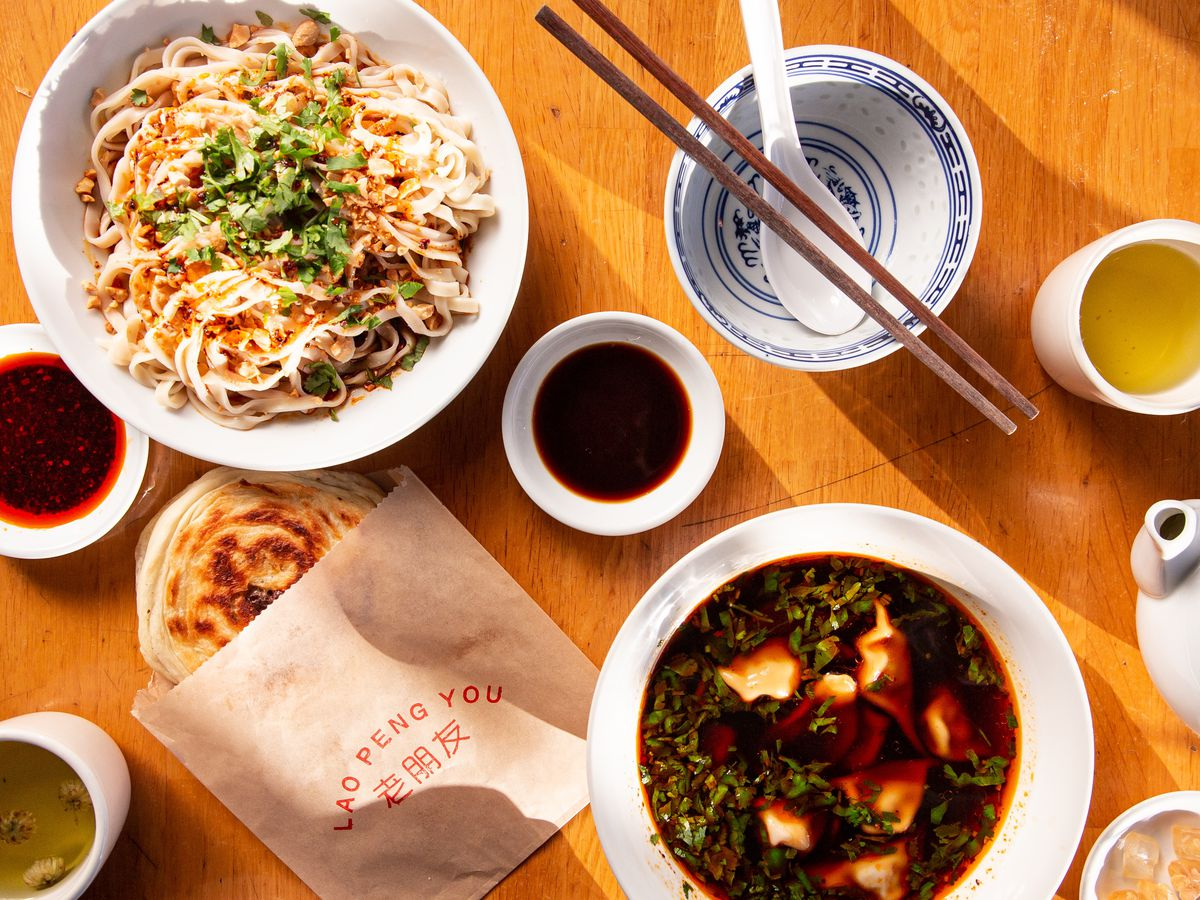 A variety of Chinese dishes on a large table.