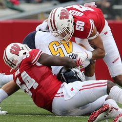 Several Badger players previously held out or restricted to limited playing time got more playing time or increased playing time vs Kent State. Here Izayah Green-May (#50) makes one of his four tackles on the day. Additionally LB Leo Chenal and NT Bryson Williams saw action.