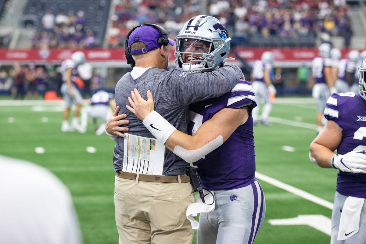 Kansas State Wildcats quarterback Skylar Thompson hugs head coach Chris Klieman as he comes off the field after a touchdown during the Allstate Kickoff Classic college football game between the Stanford Cardinal and Kansas State Wildcats on September 4, 2021 at AT&T Stadium in Arlington, TX.