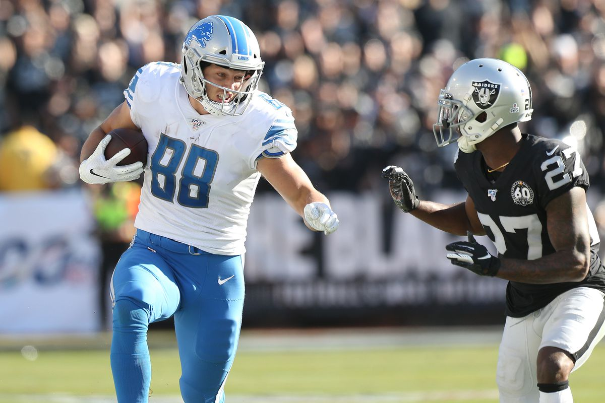 Detroit Lions tight end T.J. Hockenson runs after a pass next to Oakland Raiders cornerback Trayvon Mullen in the second quarter at Oakland Coliseum.