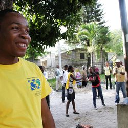 Lukenson Odney, a young Haitian LDS bishop, participates in Church-sponsored tree planting project on Wednesday.