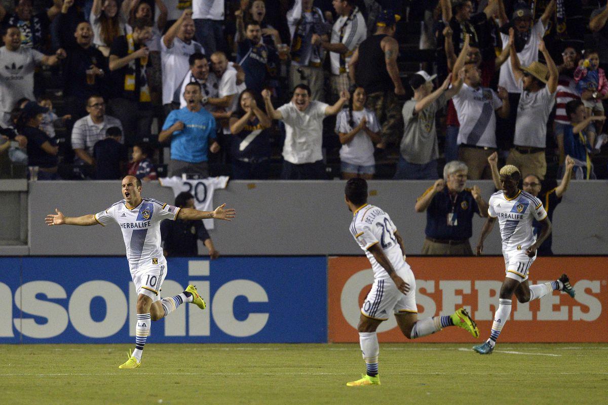 Landon Donovan (L) and the LA Galaxy had plenty of reasons to celebrate on Saturday night