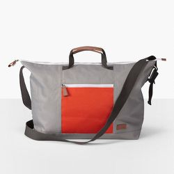 """<strong>Levi's</strong> Colorblocked Tote Bag in Grey, <a href=""""http://www.scoopnyc.com/wolverine-duffle-bag.html#image-1"""">$68</a>"""