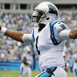 Carolina Panthers quarterback Cam Newton (1) celebrates a teammate's touchdown during the third quarter of an NFL football game against the New Orleans Saints in Charlotte, N.C., Sunday, Sept. 16, 2012.