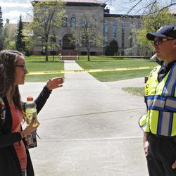 Boulder County Sheriff Sgt. Jeff Goetz, gives directions to sophomore Baylee Thenell at the Norlin Quad at the University of Colorado in Boulder, Colo., on Friday, April 20, 2012. The university closed the area and the campus from visitors to prohibit an annual 420 marijuana smoke out.