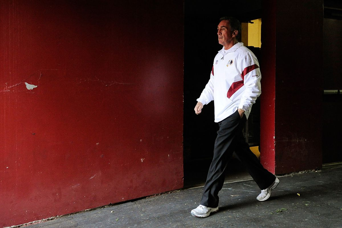 LANDOVER, MD - DECEMBER 04:  Head coach Mike Shanahan of the Washington Redskins walks onto the field prior to a game against the New York Jets at FedExField on December 4, 2011 in Landover, Maryland.  (Photo by Patrick McDermott/Getty Images)