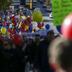 Hundreds march along State Street, filling the northbound lane from the Salt Lake City-County Building to the state Capitol during the March to End Child Abuse, organized by Protect Every Child, in Salt Lake City on Saturday, Oct. 5, 2019. The marchers carried red, yellow and blue balloons which match the logo of Protect Every Child.