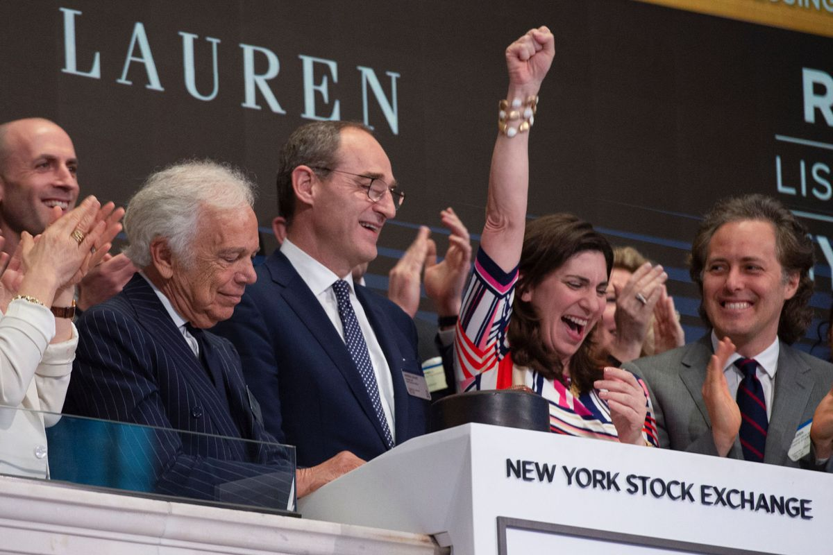 NYSE president Stacey Cunningham stands beside designer Ralph Lauren as they ring the closing bell at the New York Stock Exchange in June 2018.