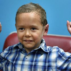 Kamden Gill does a quiet cheer after having his bandages removed by Dr. Steven Mobley at the Surgical Specialty Center in Salt Lake City on Friday, Sept. 23, 2011. Mobley performed an otoplasty to fix the 5-year-old's protruding ears.