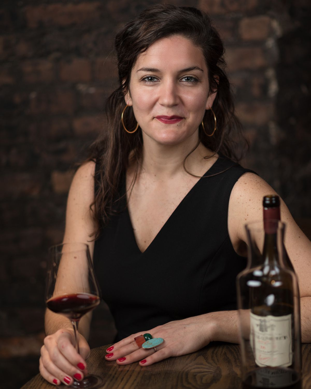 Sommelier with a glass of wine