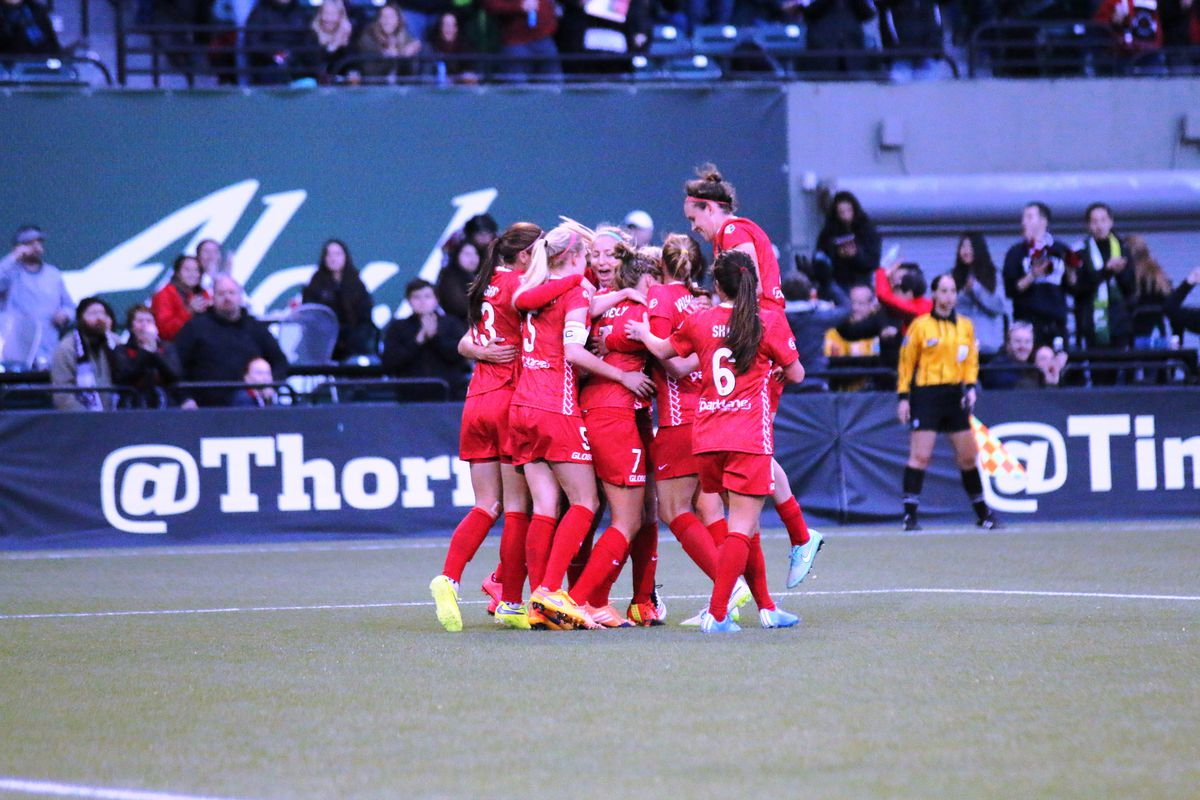 Portland Thorns mob each other after a goal in their 4-1 win over the Boston Breakers in their NWSL season opener
