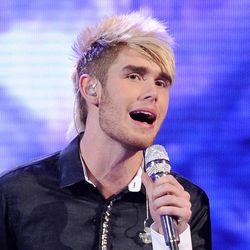 """FILE - In this April 11, 2012 file photo released by Fox, Colton Dixon performs on the singing competition series """"American Idol,"""" in Los Angeles. The 20-year-old alt-rocker was revealed Thursday, April 19, 2012 to have received the fewest viewer votes on the Fox talent competition. Dixon was surprisingly eliminated from """"Idol"""" after delivering lukewarm renditions of Lady Gaga's """"Bad Romance"""" and Earth Wind and Fire's """"September"""" on Wednesday's evening of old and new tunes."""