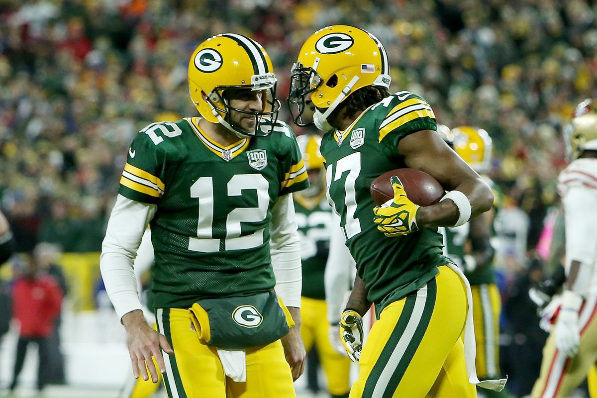 Green Bay Packers quarterback Aaron Rodgers and wide receiver Davante Adams celebrate after scoring a touchdown in the first quarter against the San Francisco 49ers at Lambeau Field on October 15, 2018 in Green Bay, Wisconsin.