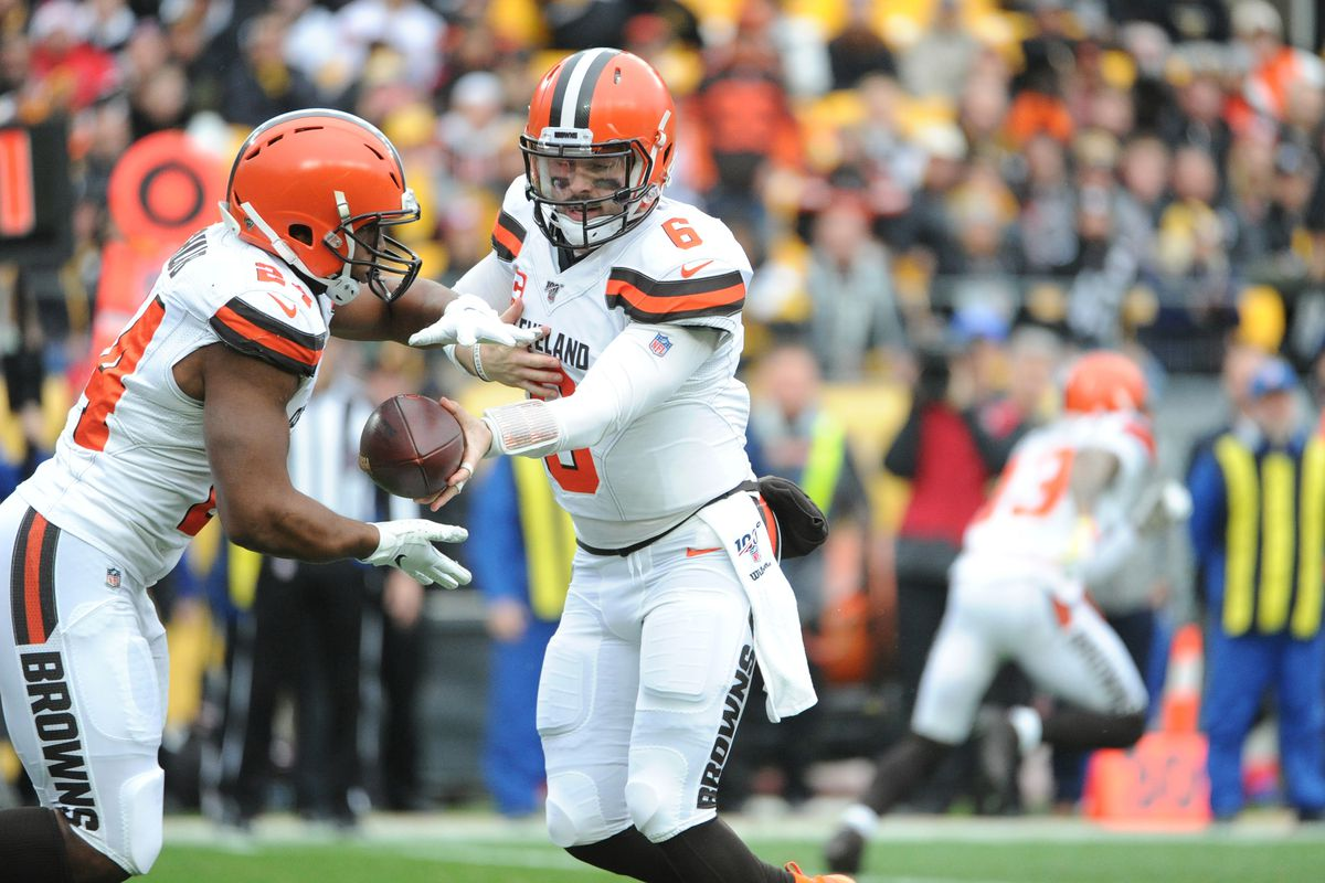 Cleveland Browns quarterback Baker Mayfield hands the ball to running back Nick Chubb against the Pittsburgh Steelers during the first quarter at Heinz Field.