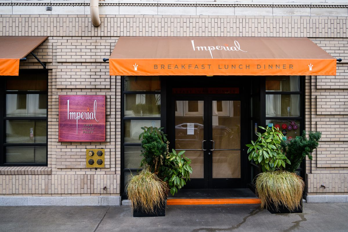 The entrance to Imperial is lined with paper, with a small sign on the door indicating that the restaurant has closed.